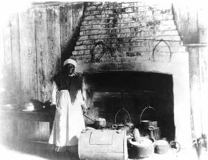A enslaved woman in a kitchen